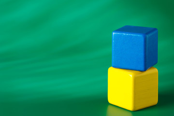 Blue & yellow blocks on green background 2