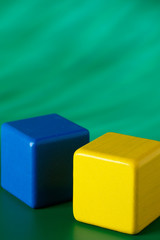 Blue & yellow blocks on green background 1