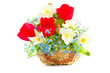 Bouquet of spring flowers in a wattled basket