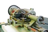 Small portable metal lathe closeup isolated poster