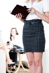 Female boss taking notes