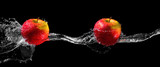 Apples in water stream