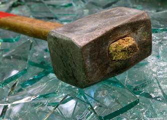 Sledge hammer and broken glass.