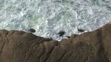 Overhead Shot of Waves Crashing Against Rocky Coast poster