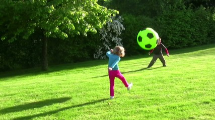 children who play balloon in the garden