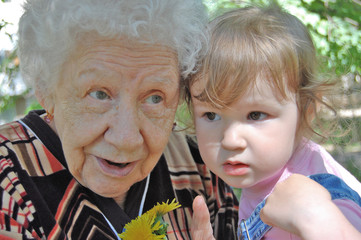 grandmother tells a fairy tale to the grand daughter