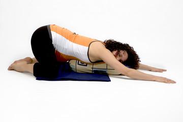 young woman excercising yoga balance