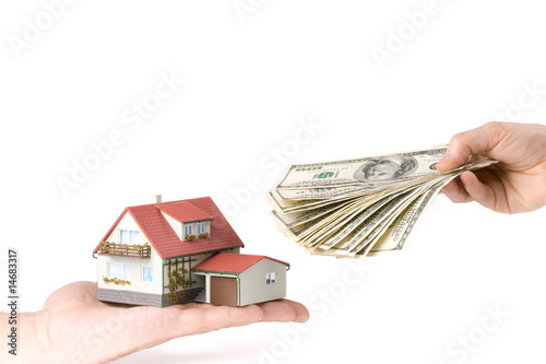 Hands with money and miniature house