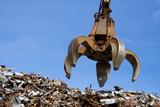 a crane grabber up on the metal  heap - 14692359