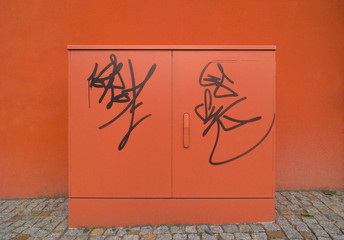 red urban connection box with graffiti