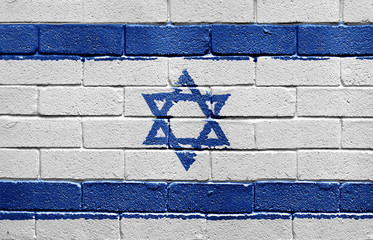 Flag of Israel on brick wall