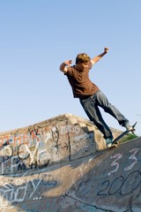 teenager playing in skateboard park