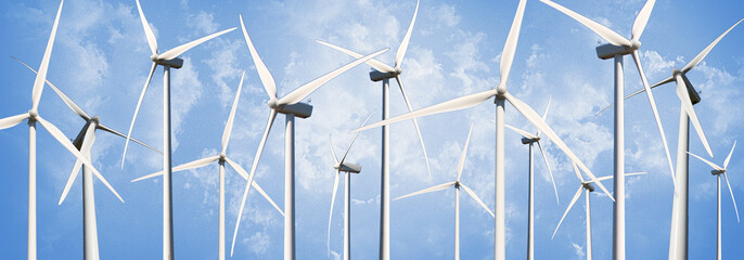 several Power Generating Windmills isolated on blue sky