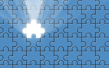 Blue puzzle with missing piece and light beam
