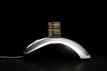 Computer mouse with a stack of coins