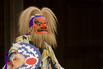 Japanese dancer with Shinto mask