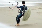 Kitesurfer preparing to enter water