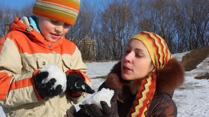 Mother and son do snowball