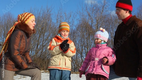 Family of four do snowball