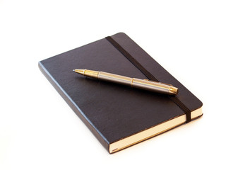 Black leather-bound notebook with pen