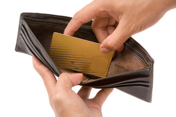Hand taking gold credit card from wallet
