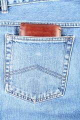 Brown wallet in jeans hip-pocket