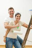 Happy couple improving home poster