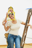 Young couple improving home poster