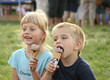 Boy and girl eat ice cream
