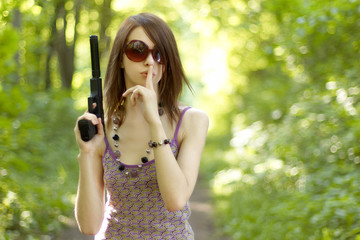 portrait of a beautiful young girl with a gun