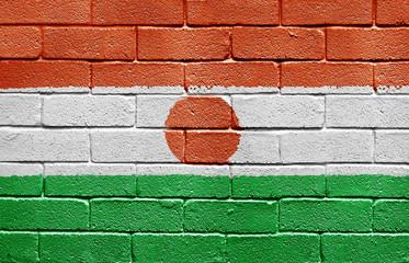 Flag of Niger on brick wall