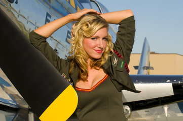 army pinup leaning on aircraft wings