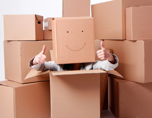 woman with smiling cardboard boxes on head