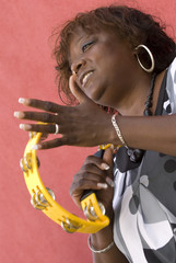woman playing tambourine