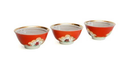 Three small porcelain bowls with floral pattern isolated