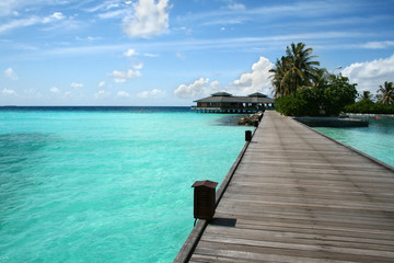 Wooden jetty on over the beautiful Maldivian beach