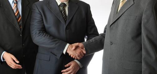 Three businessmen cooperation and handshake