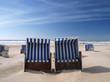 beach chairs on a deserted sunny beach