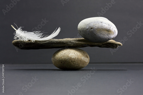Leinwandbild Motiv feather and stone balance