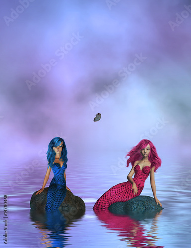Staande foto Zeemeermin PINK AND BLUE MERMAIDS SITTING ON ROCKS