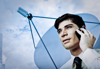 Young Professional Businessman Talks On A Mobile Phone With Sate