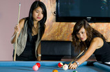 pretty asian women playing pool