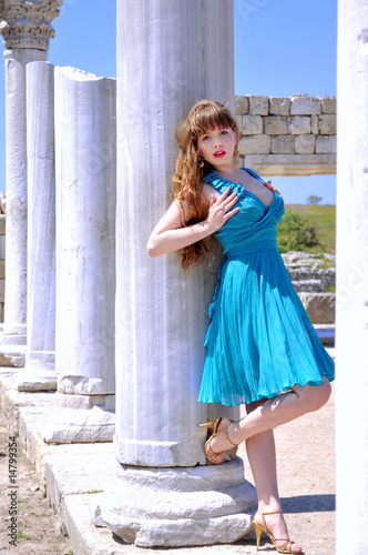 Young fashion model standing close to the  Ancient Ruins