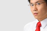 Asian businessman gazing at camera poster