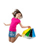 Girl holding shopping bags jumping isolated on white