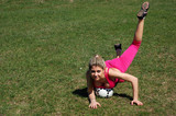 Beautiful blondie young girl with soccer ball
