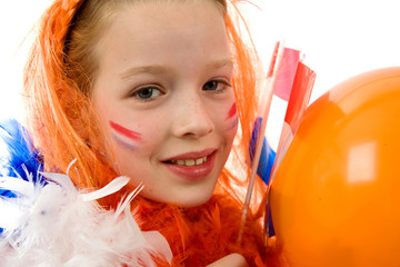 Girl is poging with orange accessories for Queens day