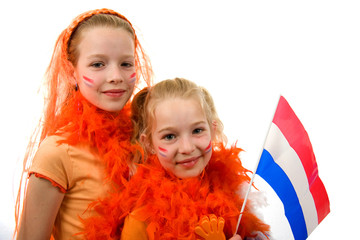 Young girls are posing with orange accessories