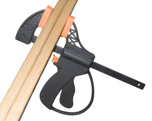 wood clamp holding lumber on white