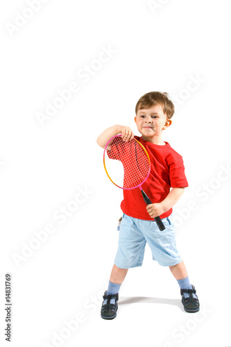 Little boy playing badminton